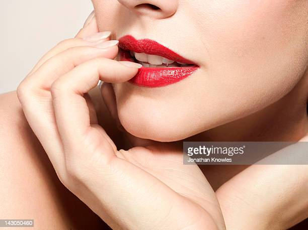 Female beauty,Close up on lips and hand, side view
