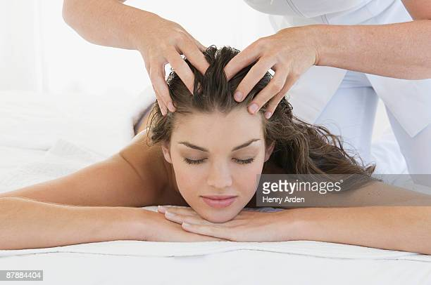 Female being given massage