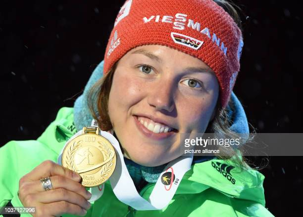 Female Biathlete Laura Dahlmeier of Germany shows her gold medal during the medal ceremony for the 10km Pursuit competition at the Biathlon World...