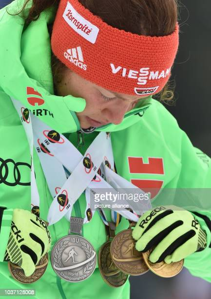 Female Biathlete Laura Dahlmeier of Germany sorts her five medals after the Women 125km Mass Start competition at the Biathlon World Championships in...