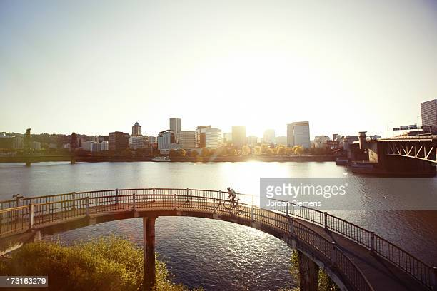 a female bike commuting. - portland oregon stock pictures, royalty-free photos & images