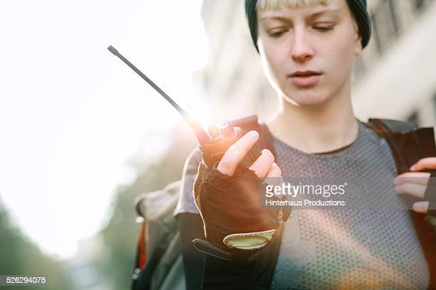 Female Bike Messenger With Walkie Talkie