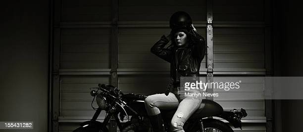 female biker putting on gear