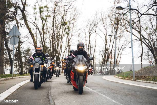 female bikers on road - riding stock pictures, royalty-free photos & images