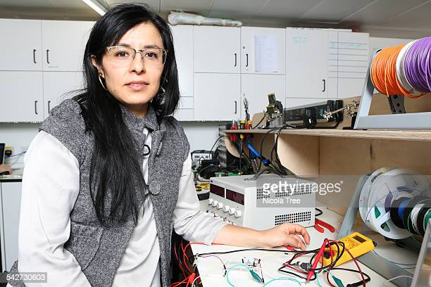 female biomedical engineer working in the lab conn