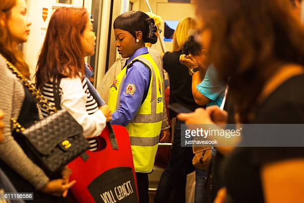 Female black security staff in airport Dubai