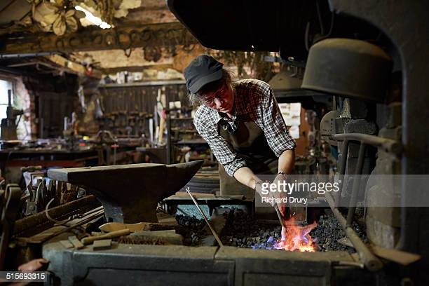 Female blacksmith in her forge