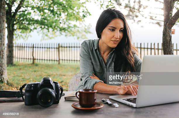 Female blogger writing on the laptop