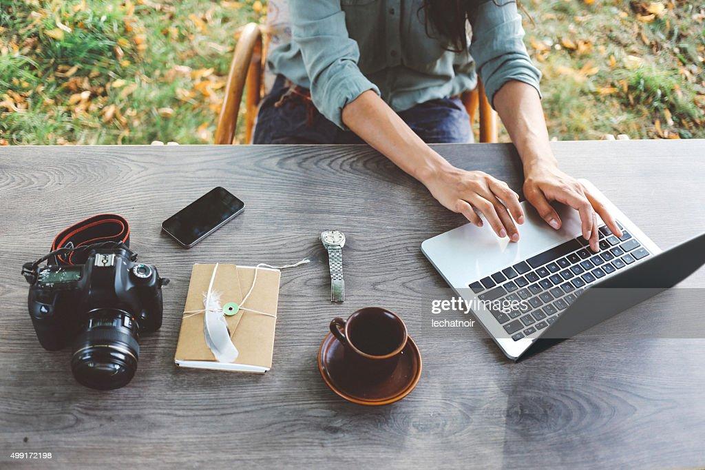Female blogger writing on the laptop : Stock Photo