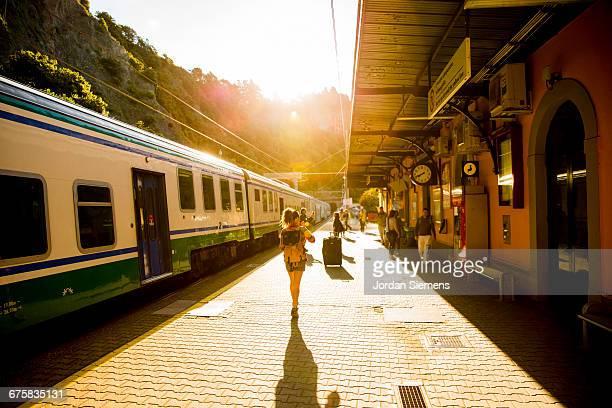 A female boarding a train.