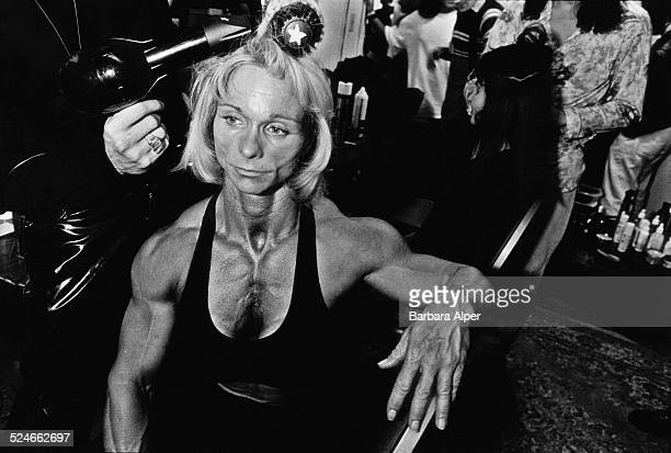 Female bodybuilder has her hair blow-dried at the 'Evolution F: A Surreal Spectacle of Female Muscle' performance in New York City, USA, 11th...