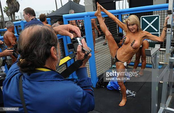 Female bodybuilder Lady Sayde poses before she competes during the annual Muscle Beach Championship bodybuilding and bikini competition at Venice...