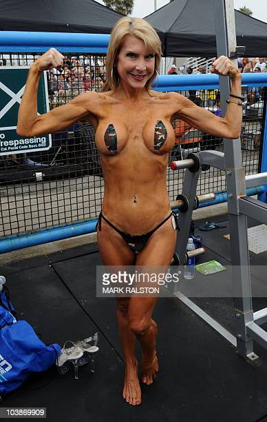 Female bodybuilder Lady Sayde warms up before she competes during the annual Muscle Beach Championship bodybuilding and bikini competition at Venice...