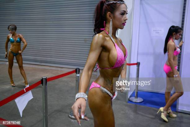 Female bodybuilder prepares backstage to compete in the Women's Model Physique contest at Impact Muang Thong Thani in Bangkok Thailand 11 November...