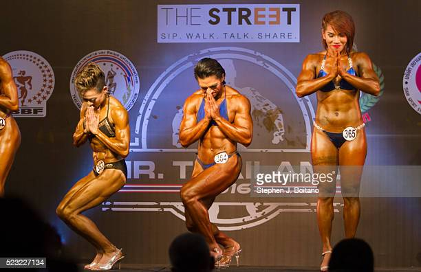 Female bodybuilders wai after a pose down during the Mr Thailand 2016 bodybuilding competition in Bangkok Thailand