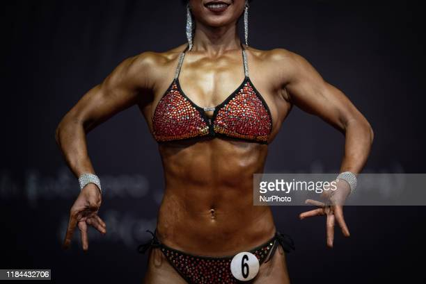 Female bodybuilding athlet poses on stage during the 46th State and Region Bodybuilding and Model Physique championship in Yangon Myanmar on 24...
