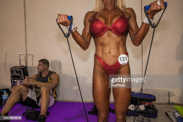 Female bodybuilding athlete warming with elastic strings in the backstage during the quotArnold Classic Europequot 2018 multisport competition in...