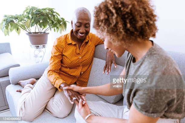 female bonding - images of black families stock pictures, royalty-free photos & images