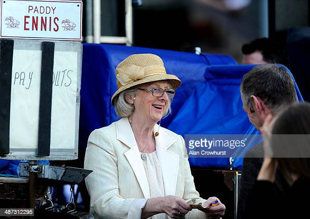 A female bookmaker enjoys paying out fifty euros to a punter at Punchestown racecourse on April 29 2014 in Naas Ireland
