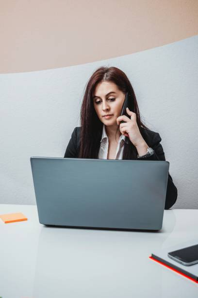 Female Boss Talking On The Phone In The Office