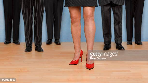 female boss/team leader - high heels stock pictures, royalty-free photos & images