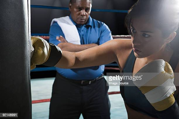 Female boxer and coach