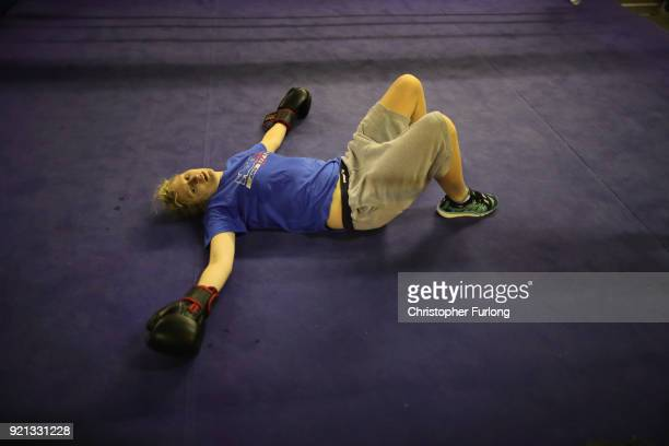 Female boxer Charliegh Carter aged 22rests on the canvas after a heavy work out at the Hook Jab Boxing Gym on September 12 2016 in Warrington England...