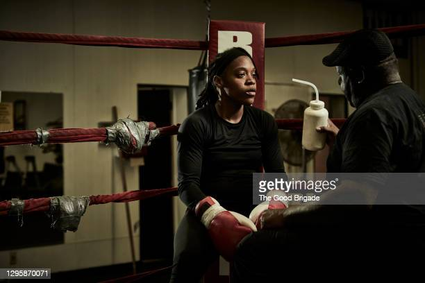 female boxer drinking water during practice at gym - boxing stock pictures, royalty-free photos & images