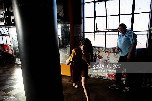 Female boxer Emma Carroll works out with long time trainer Tony O'Loughlin at the Elouera Tony Mundine Gym on Vine Street in the Aboriginal housing...
