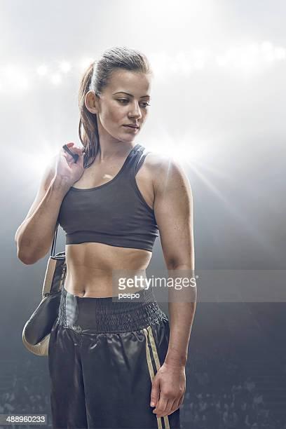 Female Boxer Holding Gloves