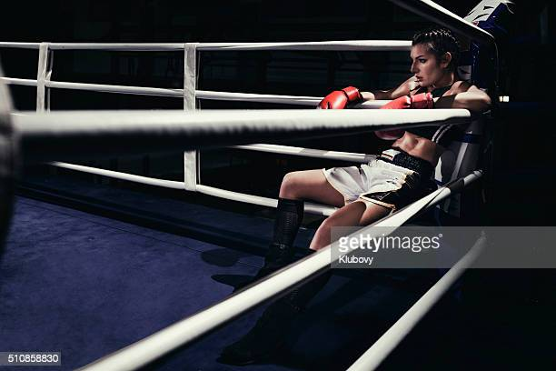 Female boxer in a boxing ring