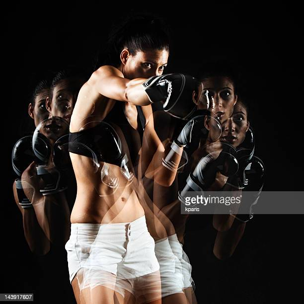 Female boxer in fast motion with various positions