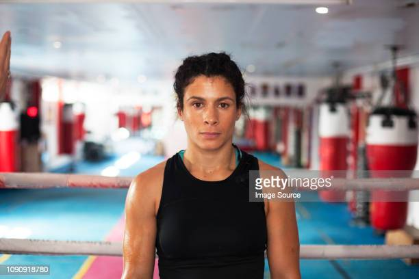 female boxer in gym - combat sport stock pictures, royalty-free photos & images