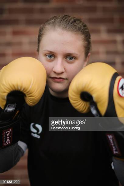 Female boxer Nicola Sayer aged 16 poses in her boxing gloves at the Hook Jab Boxing Gym on September 12 2016 in Warrington England The popularity of...