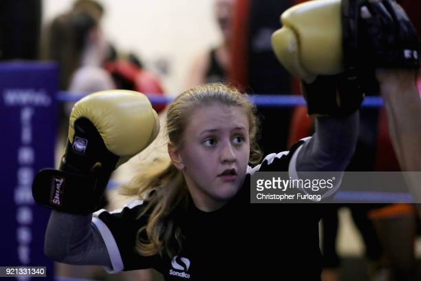 Female boxer Nicola Sayer aged 16 trains in the ring with Great Britain performance coach Amanda Groarke at the Hook Jab Boxing Gym on September 12...