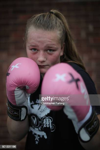 Female boxer Olivia Hussey aged 16 poses with her pink boxing gloves at the Hook Jab Boxing Gym on September 12 2016 in Warrington England The...