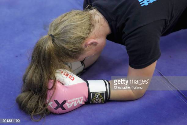 Female boxer Olivia Hussey aged 16 rests on the canvas after a heavy workout at the Hook Jab Boxing Gym on September 12 2016 in Warrington England...