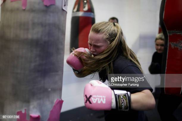 Female boxer Olivia Hussey aged 16 trains at the punch bag at the Hook Jab Boxing Gym on September 12 2016 in Warrington England The popularity of...