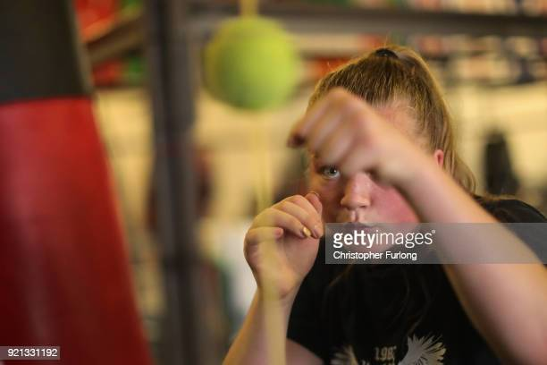 Female boxer Olivia Hussey aged 16 trains her accuracy by punching a suspended tennis ball at the Hook Jab Boxing Gym on September 12 2016 in...