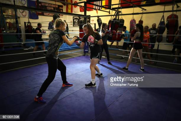 Female boxer Olivia Hussey aged 16 trains in the ring with Great Britain performance coach Amanda Groarke at the Hook Jab Boxing Gym on September 12...