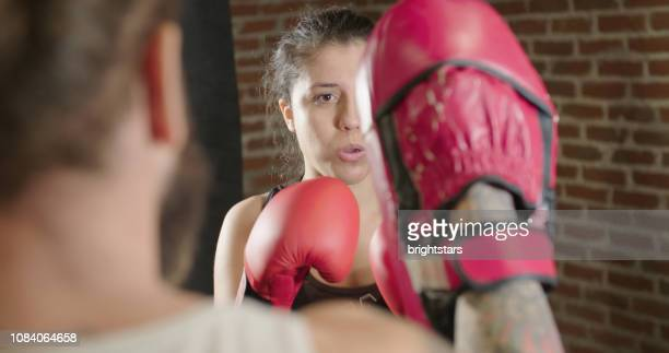 female boxer pad training - padding stock pictures, royalty-free photos & images