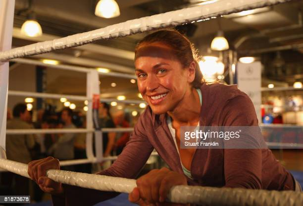 Female boxer S' Kati Katz of Germany during public training at a Karstadt sports shop on July 9 2008 in Hamburg Germany