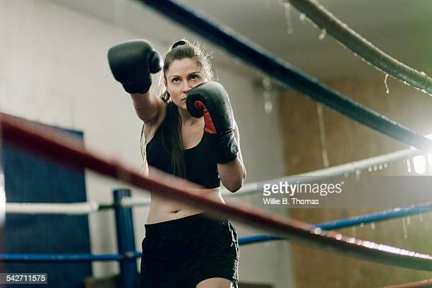 female boxer shadow boxing - boxing ring stock pictures, royalty-free photos & images