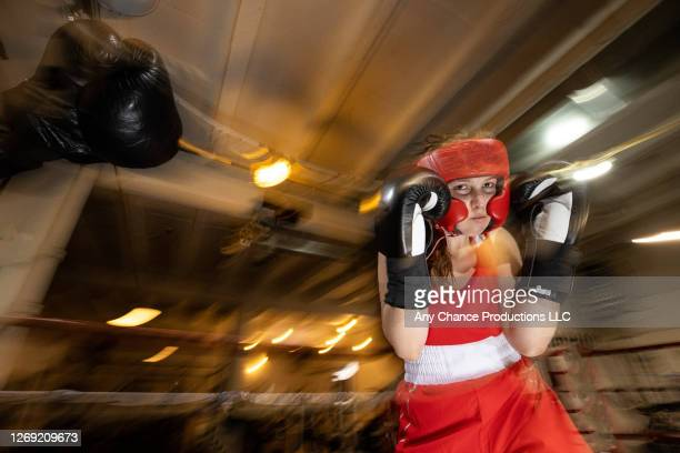 female boxer sparring. - punching stock pictures, royalty-free photos & images