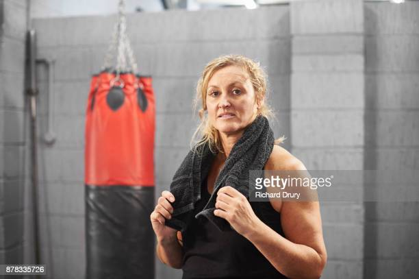 Female boxer standing in gym