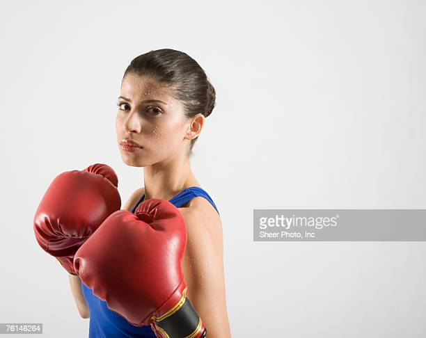 female boxer, studio shot - fighting stance stock pictures, royalty-free photos & images