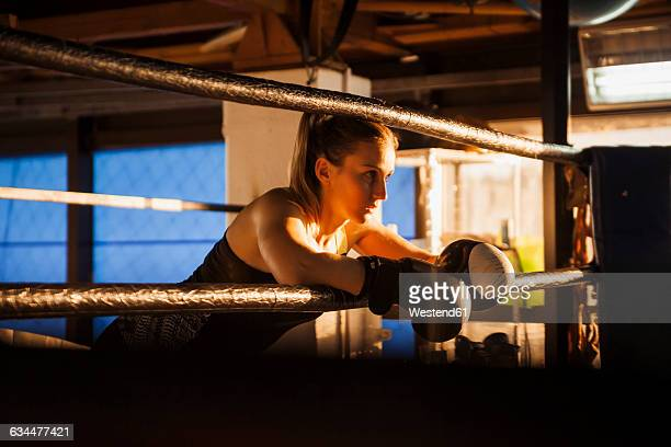 Female boxer taking a rest