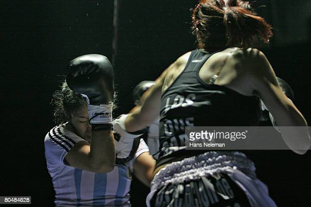Female boxer with her sparring