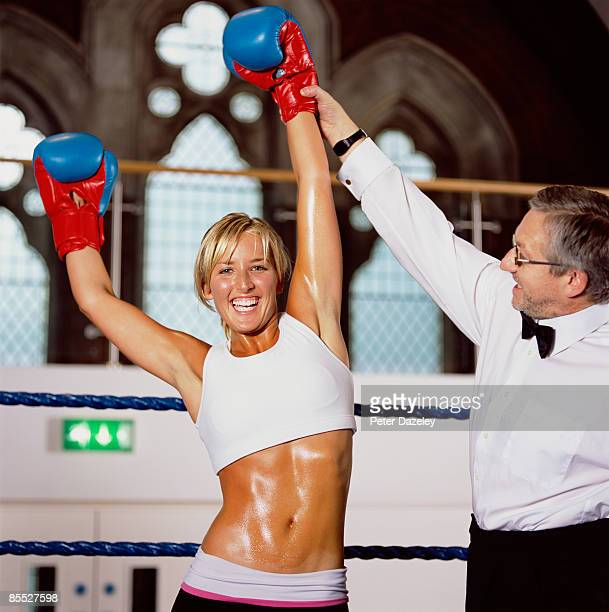 female boxer with referee - female umpire stockfoto's en -beelden