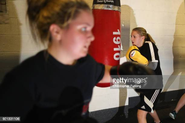 Female boxers Ellie Hyde and Nicola Sayer both aged 16 workout at the punch bags during training at the Hook Jab Boxing Gym on September 12 2016 in...